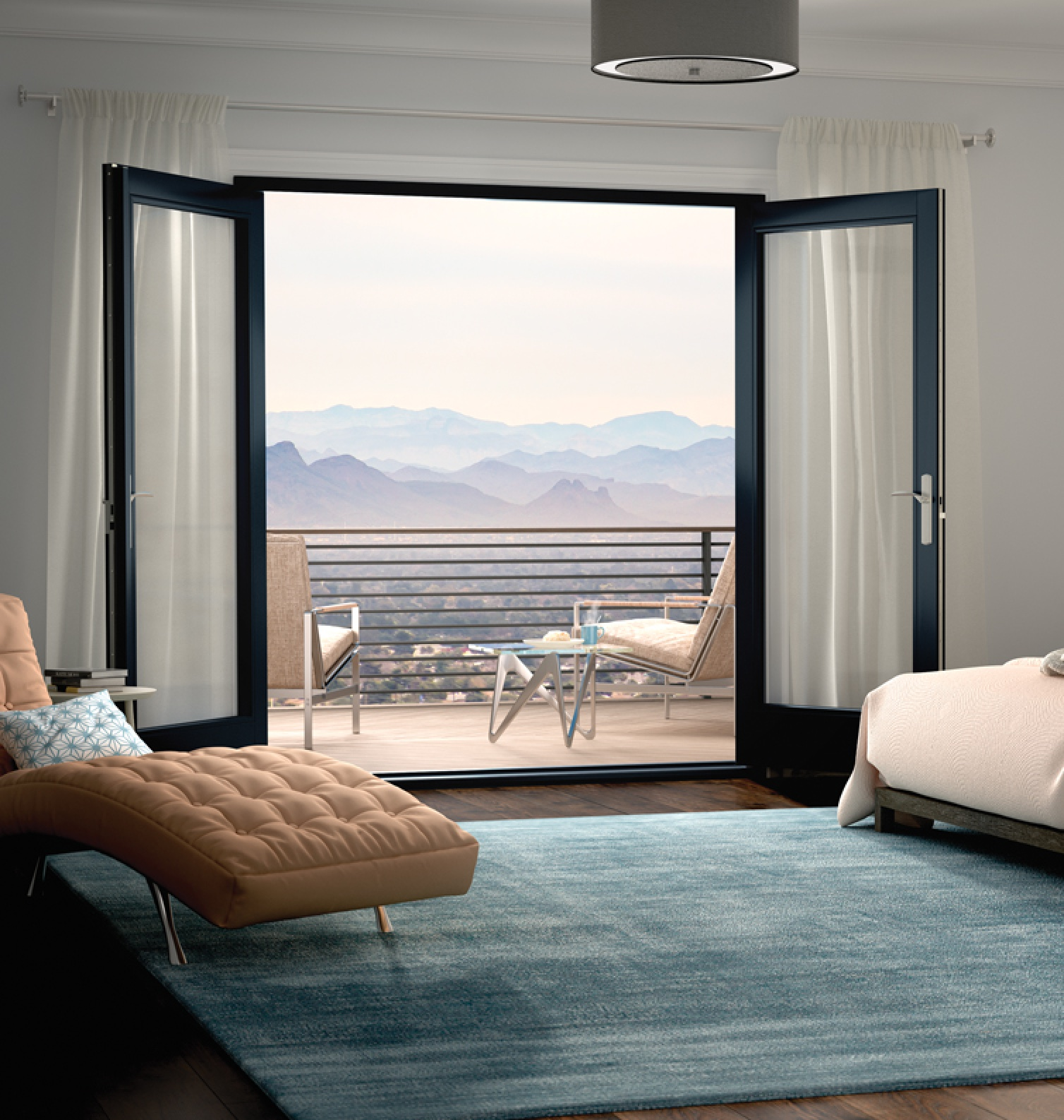 Glass French doors from The Folding Door Store that open onto a balcony overlooking mountains.