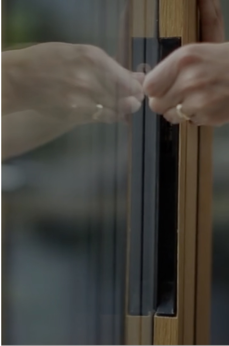 Close up of hand opening a sliding door