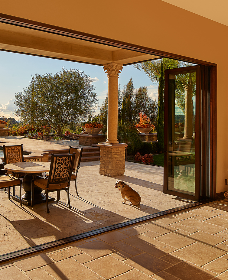 Brighten the interior of your home with The Folding Door Store's sliding glass doors and other enhancements.