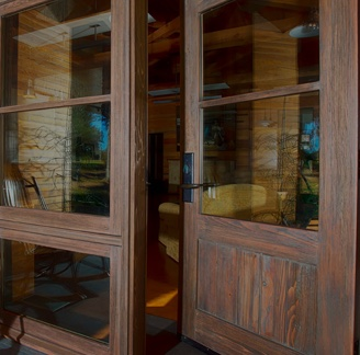 Custom wooden entry doors installed at a home and made by The Folding Door Store experts.